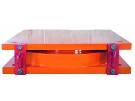 An orange color pot bearing with thick top steel plate and bottom steel plate.